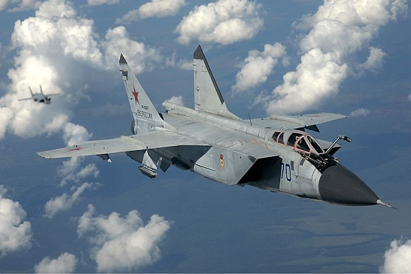 """Russian Air Force MiG-31 inflight Pichugin"" by Dmitriy Pichugin - http://www.airliners.net/photo/Russia---Air/Mikoyan-Gurevich-MiG-31/2040593/L/. Licensed under GFDL 1.2 via Commons - https://commons.wikimedia.org/wiki/File:Russian_Air_Force_MiG-31_inflight_Pichugin.jpg#/media/File:Russian_Air_Force_MiG-31_inflight_Pichugin.jpg"